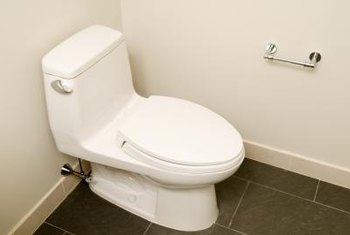 A toilet needs proper clearance from both the back and side walls.