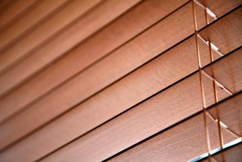 Maintain wood blinds by dusting regularly and only using cleaners approved for wood.