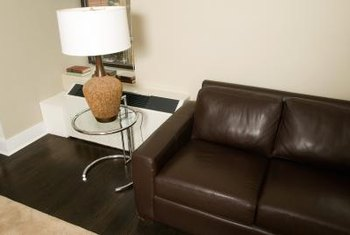 Enhance a contemporary leather sofa with a modern glass end table.