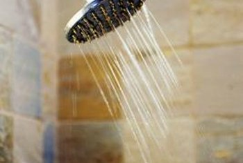 Water filters attached to the shower head help to control water mineral content.
