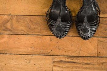 Dents, dings and discoloration make a wood floor look more rustic.