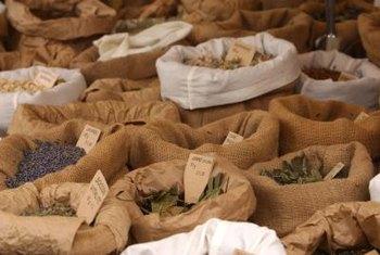 Unpick The Seams Of Burlap Bags To Yield Useful Fabric.
