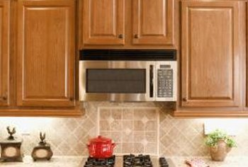 You don't have to disrupt your tile design to hang a microwave over the stove.