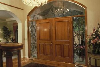 Baldwin handles complement large, ornate entry doors.