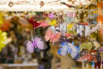 Fabric butterflies will flutter from a hoop that anchors ceiling fabric.