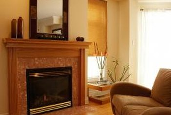 Framing around the front of a fireplace gives hardwood floors a professional finish.