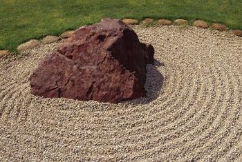 A single blade of grass can make gravel landscape features look messy.