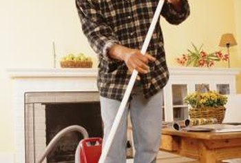 A broom and a vacuum are ideal tools for cleaning wood floors.