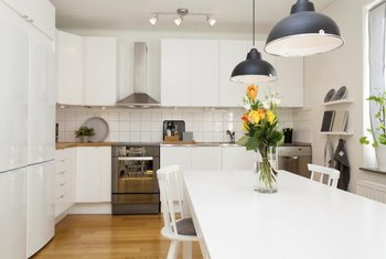 Track Light In Kitchen: Track lights can provide ambient, task and accent lighting in a kitchen.,Lighting