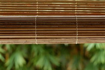 Bamboo blinds add natural-looking privacy to a balcony.