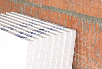 Rigid insulation boards can be glued or screwed to existing walls.