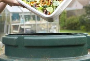 Adding kitchen scraps to a compost keeps them out of the landfill.