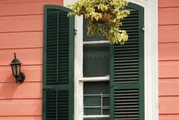 Dark shutters provide a striking contrast against a light house color.