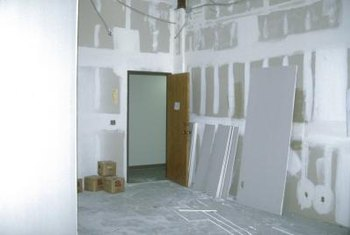 A lift holds drywall securely in place until you can fasten it.