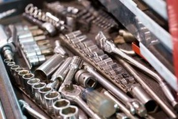 You'll need several types of wrenches to adjust your Briggs & Stratton engine's timing.