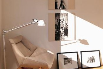 Pictures hung vertically give a wall the illusion of height.