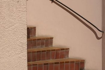 Anchor stair rails securely to the wall for safety.