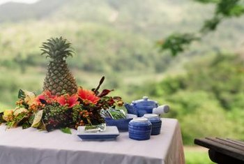 Feature a festive party table by using fresh pineapple as the centerpiece.