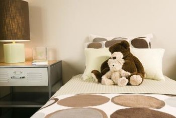 A couple of stuffed animals at the head of a teen's bed can be cute without being childish.