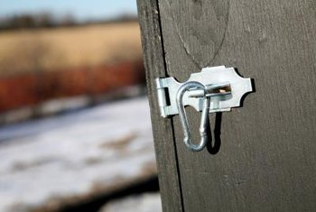Add a lock and latch to outdoor storage boxes.