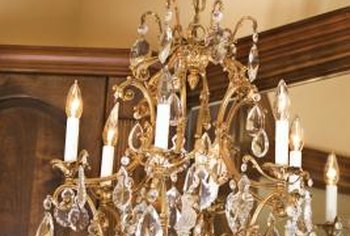 Swag a chandelier so that it sits 30 to 34 inches above the dining room table.