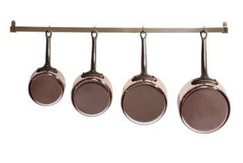 You can hang pots and pans from a wall-mounted pot rail.