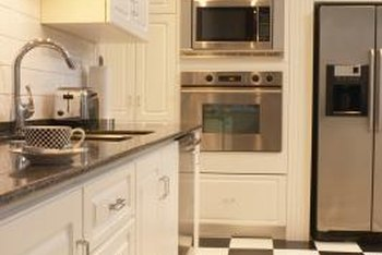 Coordinate floor tiles with countertops for a well-designed kitchen.