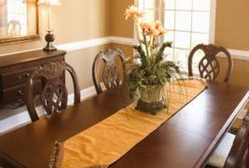 Tan walls and crisp white woodwork create a neutral backdrop for your dining room decor.