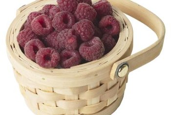 A weed-free raspberry patch can bring higher yields of better quality fruit.