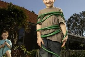 Teaching children to take care of a garden hose may prevent tangles.