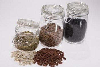 Storing bean seeds in glass jars keeps them dry.