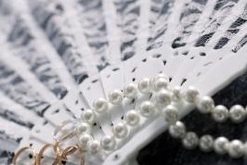 This delicate lace fan would look lovely displayed in a shabby chic shadowbox.