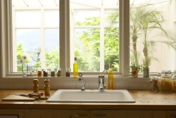 Wood counter tops next to sinks require waterproofing.