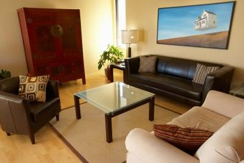Neutral colors create a calm atmosphere for a room with brown leather furniture.
