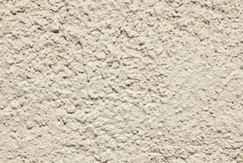 If the plaster is stucco, you can drill into it easily.