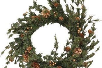 A wreath can be suspended from a glass door as long as it's not too heavy.