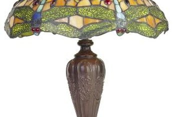 Designed by Clara Driscoll, the famed Dragonfly lamp displays irregular lower borders.