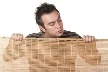 Bamboo blinds, composed of thin bamboo reeds and rope, work perfectly for a headboard.