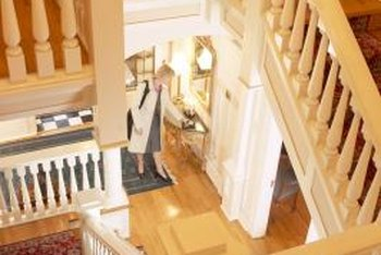 An all-white banister is crisp and clean, working with a variety of decorating styles.