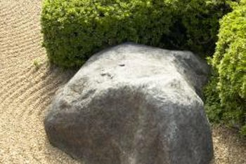 How to Move Landscape Boulders | Home Guides | SF Gate Boulders In Garden Design on trees in garden design, gravel in garden design, boulders in landscape,