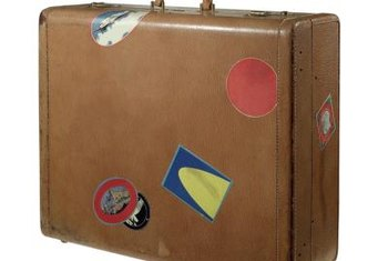 A stiff brush and gentle soap or vinegar water removes mold from vintage luggage.