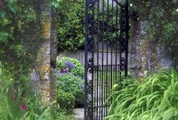 The manmade hardness of the gated entrance is softened by the addition of landscaping features.
