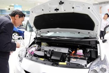Under the hood, a hybrid vehicle includes an electric motor to provide partial or full drive-power.