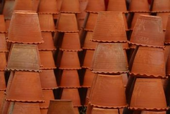 White powder on terra-cotta pots is harmless and removable.