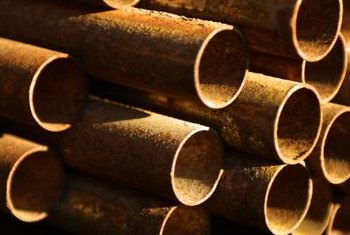 Rusty iron pipes are the main cause of red residue.