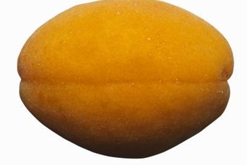 Apricot pits can be removed from mature apricots from July through September, depending on the variety.