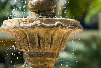 Mineral deposits can clog the intake on a fountain's water pump if not addressed.