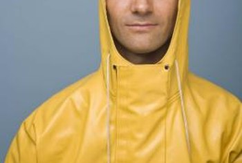 Wear protective rain gear when working on a roof in bad weather.