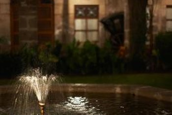Highlight the fountain's moving water with strategic lighting.