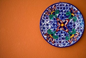 A heavy plate can be hung on the wall using a wire plate hanger.